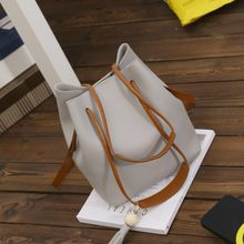 BAGuette - Tasseled Faux Leather Bucket Bag