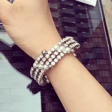 Ticoo - Multi-Strand Rhinestone Faux Pearl Bangle